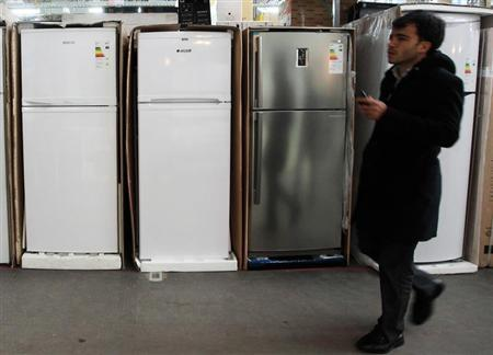 A man walks past refrigerators on sale at a store in Istanbul, October 18, 2011. REUTERS/Osman Orsal