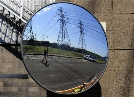 Power lines are reflected in a mirror at the Rio Tinto power station in Lynemouth, northern England July 2, 2009. REUTERS/Nigel Roddis