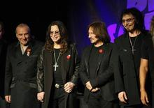 Original members of the rock band Black Sabbath, Bill Ward (L), Ozzy Osborne (2nd L), Geezer Butler and Tony Lommi (R), announce their reunion during a news conference at the Whiskey A Go Go, the club where the band first performed 41 years ago, in Los Angeles, California November 11, 2011. REUTERS/David McNew