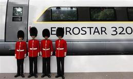 Four members of the Scot's Guards pose for a photograph next to a new Eurostar train, during a media event, in central London, October 7, 2010. REUTERS/Andrew Winning