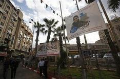 A banner depicting Mohammed Assaf, a contestant in the TV talent show 'Arab Idol', hangs from poles in the West Bank city of Ramallah May 13, 2013. REUTERS/Mohamad Torokman
