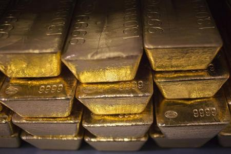 Twenty four karat gold bars are seen at the United States West Point Mint facility in West Point, New York June 5, 2013. REUTERS/Shannon Stapleton