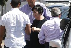 Johanna Antonacci (C), the sister of Soprano's star James Gandolfini, is shielded by security as she arrives at the Rome morgue where the body of her brother is being held following an autopsy earlier in the day June 21, 2013. REUTERS/Tony Gentile