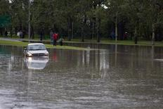 A truck sits abandoned and submerged on Memorial Drive after the Bow River flooded in Calgary, Alberta June 21, 2013. REUTERS/Todd Korol