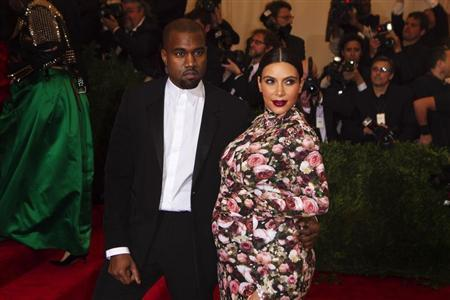 Singer Kanye West and reality television actress Kim Kardashian arrive at the Metropolitan Museum of Art Costume Institute Benefit celebrating the opening of ''PUNK: Chaos to Couture'' in New York, May 6, 2013. REUTERS/Lucas Jackson