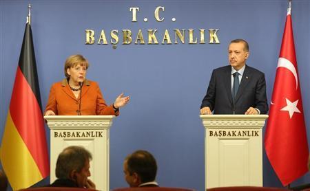 German Chancellor Angela Merkel and Turkey's Prime Minister Tayyip Erdogan (R) attend a joint news conference in Ankara February 25, 2013. REUTERS/Altan Burgucu