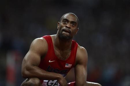 Tyson Gay of the U.S. reacts after finishing fourth in the men's 100m final during the London 2012 Olympic Games at the Olympic Stadium August 5, 2012. REUTERS/Dylan Martinez