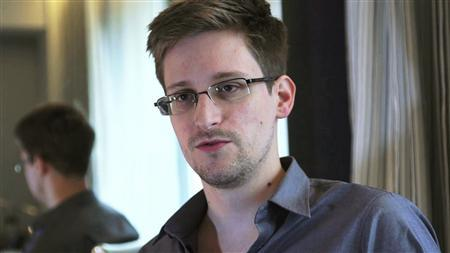 NSA whistleblower Edward Snowden, an analyst with a U.S. defence contractor, is seen in this file still image taken from video during an interview by The Guardian in his hotel room in Hong Kong June 6, 2013. REUTERS/Glenn Greenwald/Laura Poitras/Courtesy of The Guardian/Handout via Reuters