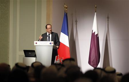 French President Francois Hollande speaks during the opening of the Qatari-French Business Forum in Doha June 23, 2013. REUTERS/Mohammed Dabbous