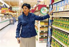 PepsiCo CEO Indra Nooyi poses for a portrait by products at the Tops SuperMarket in Batavia, New York, June 3, 2013. REUTERS/Don Heupel