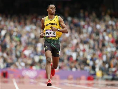 Jamaica's Warren Weir runs to finish first in his men's 200m round 1 heat at the London 2012 Olympic Games at the Olympic Stadium August 7, 2012. REUTERS/Lucy Nicholson