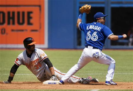 Baltimore Orioles Chris Dickerson (L) is safe at second after Toronto Blue Jays Munenori Kawasaki applied the tag during the first inning of their MLB American League baseball game in Toronto, June 23, 2013. REUTERS/Mark Blinch