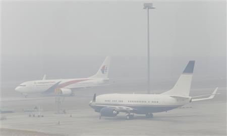 Airplanes are seen at the Kuala Lumpur International Airport in Sepang, on a hazy day outside Kuala Lumpur June 24, 2013. . REUTERS/Bazuki Muhammad