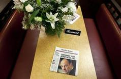 """A newspaper and bouquet of flowers adorn a booth in Holsten's Ice Cream Shop, which was the location of the final scene where the TV show """"The Sopranos"""" was filmed, in Bloomfield, New Jersey, June 20, 2013. REUTERS/Carlo Allegri"""