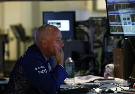 A trader works on the floor at the New York Stock Exchange, June 24, 2013. REUTERS/Brendan McDermid