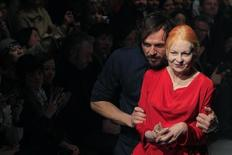 British designer Vivienne Westwood (R) appears next to her husband Andreas Kronthaler at the end of her Fall-Winter 2013/2014 women's ready-to-wear fashion collection during Paris Fashion Week March 2, 2013. REUTERS/Gonzalo Fuentes