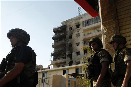 Lebanese army soldiers patrol the area of a mosque complex, where hardline Sunni cleric Sheikh Ahmed al-Assir was believed to be sheltering with his supporters in Abra near Sidon, southern Lebanon, June 24, 2013. REUTERS-Ali Hashisho
