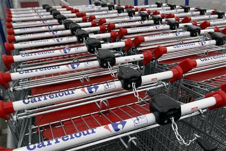 View of shopping trolleys on a parking lot at the Carrefour hypermarket in Rosny sous Bois, east of Paris, April 30, 2013. REUTERS/Charles Platiau