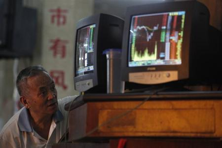An investor looks at a computer screen showing stock information at a brokerage house in Shanghai June 25, 2013. REUTERS/Aly Song