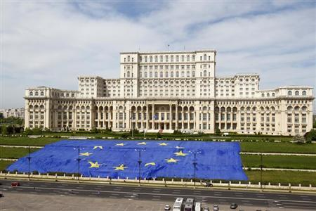 A large European Union flag is displayed in front of Romania's Parliament Building to mark EU Day in Bucharest May 9, 2013. The flag measures 140 by 100 meters (460 by 330 feet) and weighs 800kg (1,764 pounds), according to organisers. REUTERS/Bogdan Cristel
