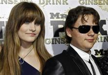 Paris and her brother Prince, children of the late Michael Jackson, arrive at the Mr. Pink Ginseng Drink launch party at the Beverly Wilshire Hotel in Beverly Hills, California, October 11, 2012. REUTERS/Jonathan Alcorn
