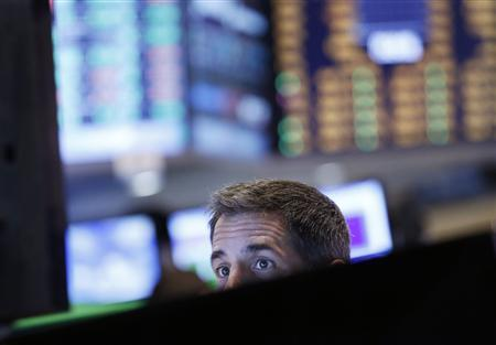 A trader watches his screen on the floor at the New York Stock Exchange, June 25, 2013. REUTERS/Brendan McDermid