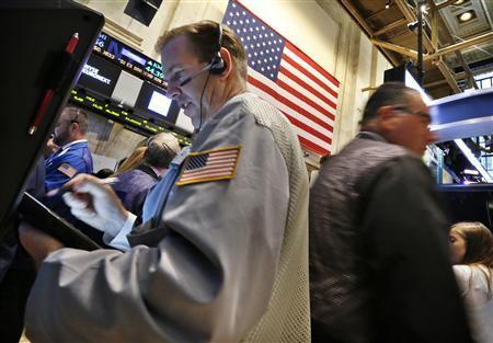Traders work on the floor at the New York Stock Exchange, June 25, 2013. REUTERS/Brendan McDermid