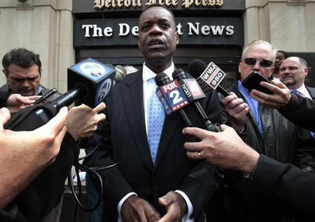 Detroit's Emergency Financial Manager Kevyn Orr talks to members of the media outside the Detroit Newspapers building about the report he delivered to the State of Michigan about Detroit's finances in Detroit, Michigan May 13, 2013. REUTERS/ Rebecca Cook