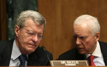 Senator Max Baucus (D-MT) (L), the chairman of the Senate Finance Committee, and Senator Orrin Hatch (R-UT), the co-chair, confer during testimony in Washington May 21, 2013. REUTERS/Gary Cameron