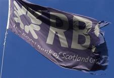A Royal Bank of Scotland flag flies over a building in the City of London November 2, 2009. REUTERS/Andrew Winning