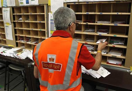 A Royal Mail worker sorts letters at the Edinburgh mail centre in Edinburgh, Scotland December 18, 2012. REUTERS/David Moir