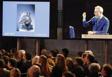 Christie's auctions a bronze rat head made for the Zodiac fountain of the Emperor Qianlong's Summer Palace in China from the private art collection of late French fashion designer Yves Saint Laurent at the Grand Palais Museum in Paris in this February 25, 2009 file photo. REUTERS/Regis Duvignau/Files
