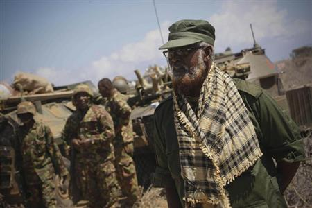 Sheik Ahmed Madobe, commander of the Ras Kimboni Militia Brigade, which is allied to the Somali National Army, looks on in Saa'moja, approximately 7km (4.3 miles) outside the Somali port city of Kismayu in this October 1, 2012 handout photograph released by the African Union-United Nations Information Support Team. REUTERS/African Union-United Nations Information Support Team/Stuart Price/Handout