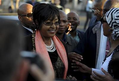 South Africa's Mandela 'improving' as Obama flies in