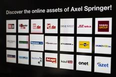 Logos of the digital products of the Axel Springer media group are presented before a news conference on annual results in Berlin March 6, 2013. REUTERS/Thomas Peter