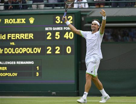 David Ferrer of Spain celebrates after defeating Alexandr Dolgopolov of Ukraine in their men's singles tennis match at the Wimbledon Tennis Championships, in London June 29, 2013. REUTERS/Toby Melville (BRITAIN - Tags: SPORT TENNIS)
