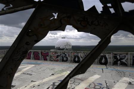 Broken antenna covers of Former National Security Agency (NSA) listening station are seen at the Teufelsberg hill (German for Devil's Mountain) in Berlin, June 30, 2013. The United States taps half a billion phone calls, emails and text messages in Germany in a typical month and has classed its biggest European ally as a target similar to China, according to secret U.S. documents quoted by a German newsmagazine. The revelations of alleged U.S. surveillance programmes based on documents taken by fugitive former National Security Agency contractor Edward Snowden have raised a political furore in the United States and abroad over the balance between privacy rights and national security. REUTERS/Pawel Kopczynski