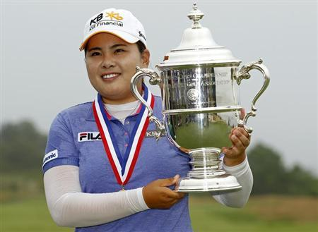 nbee Park of South Korea holds the 2013 Harton S. Semple Trophy after winning the 2013 U.S. Women's Open golf championship at the Sebonack Golf Club in Southampton, New York June 30, 2013. REUTERS/Adam Hunge