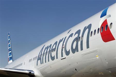 An American Airlines aircraft is on the ramp at Dallas-Ft Worth International Airport February 14, 2013. REUTERS/Mike Stone