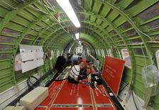 Bombardier employees install parts in the cabin of a Global 6000 aircraft at the manufacturing facilities in Toronto May 29, 2012. REUTERS/ Mike Cassese