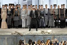 German designer Karl Lagerfeld (front C) appears with models at the end of his Haute Couture Fall Winter 2013/2014 fashion show for French fashion house Chanel in Paris July 2, 2013. REUTERS/Charles Platiau
