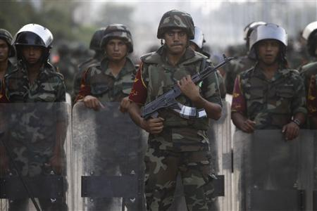 Army soldiers take their positions in front of protesters who are against Egyptian President Mohamed Mursi, near the Republican Guard headquarters in Cairo July 3, 2013. REUTERS/Amr Abdallah Dalsh