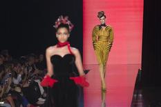 Models present creations by French designer Jean Paul Gaultier as part of his Haute Couture Fall Winter 2013/2014 fashion show in Paris July 3, 2013. REUTERS/Gonzalo Fuentes