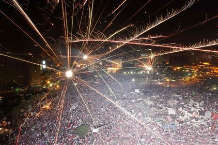 Protesters against Egyptian President Mohamed Mursi set-off fireworks in Tahrir Square in Cairo July 3, 2013. Jubilant crowds across Cairo cheered, chanted pro-army slogans and set off fireworks after the military suspended the constitution and overthrew President Mohamed Mursi on Wednesday. REUTERS/Mohamed Abd El Ghany