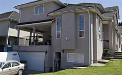 The exterior of the apartment rented to suspects John Nuttall and Amanda Korody is pictured in Surrey, British Columbia July 3, 2013. REUTERS/Andy Clark