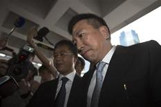 Former feng shui practitioner Peter Chan Chun-chuen(R), formerly known as Tony Chan, arrives at the Supreme Court in Hong Kong July 4, 2013. REUTERS/Tyrone Siu