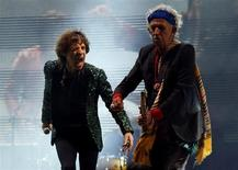 Mick Jagger (L) and Keith Richards of the Rolling Stones perform on the Pyramid Stage at Glastonbury music festival at Worthy Farm in Somerset, June 29, 2013. REUTERS/Olivia Harris