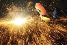 A worker welds inside a factory in Chongqing municipality, June 25, 2013. REUTERS/China Daily