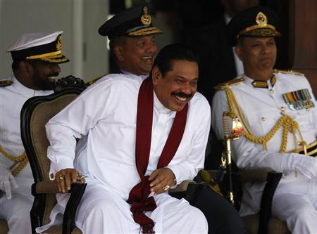 Sri Lanka's President Mahinda Rajapaksa smiles during the War Victory Parade, in Colombo May 18, 2013. REUTERS/Dinuka Liyanawatte