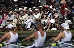 Spectators wearing straw hats watch the rowers go past at the Henley Royal Regatta, an annual rowing event first held in 1839 in Henley-on-Thames, southern England July 5, 2013. REUTERS/Eddie Keogh